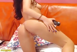 Kinky Latin Beauty Glaring Seductively And Masturbating Hard
