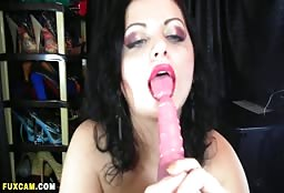 Beautiful Brunette Sucking A Sex Toy