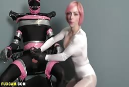 Pink Haired Super Hero Pleasing Her Encased Man To The Max