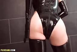 Sexy Blonde Cam Model In A Latex Custome Has An Amazing Ass